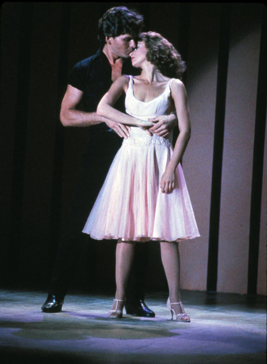 In this undated file photo provided by Lionsgate Home Entertainment, actors Patrick Swayze, portraying Johnny Castle, and Jennifer Grey, portraying Baby Houseman, are shown in a scene from the film, ""