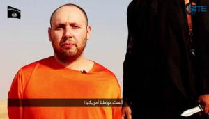 A video purportedly shows U.S. journalist Steven Sotloff kneeling next to a masked Islamic State fighter holding a knife in an unknown location in this still image from video released by Islamic State