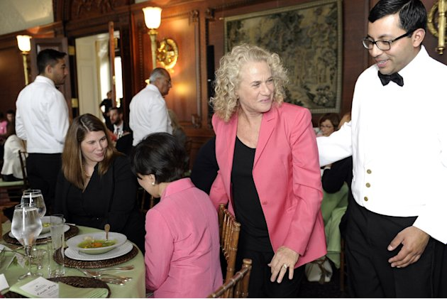 Singer-songwriter Carole King, second from right, walks past Rep. Doris Matsui, D-Calif., center, during a luncheon at the Library of Congress in Washington, Tuesday, May 21, 2013, to honor King.  Car
