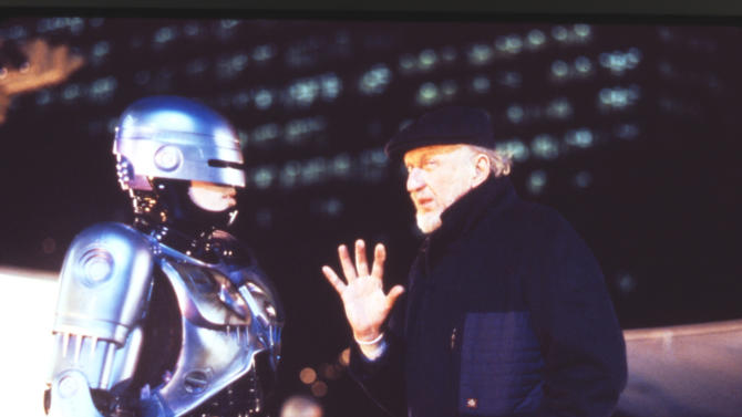 "FILE - This 1990 file photo released by Orion Pictures Corp. shows film director Irvin Kershner, right, and actor Peter Weller, portraying Robocop, during the making of ""Robocop II."" Plans are moving forward for a Detroit statue of the fictional crime-fighting cyborg RoboCop. The Detroit News reports Wednesday, April 4, 2012 that a RoboCop model is being scanned at a studio in Canada. When the scanning process is completed, artists will create foam pieces that will be shipped to Detroit's Venus Bronze Works, where the parts of the statue will be cast.    (AP Photo/Orion Pictures Corp., Deana Newcomb, File)"