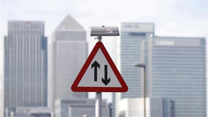 File photo of a traffic sign in front of the skyline of the the Canary Wharf financial district in London