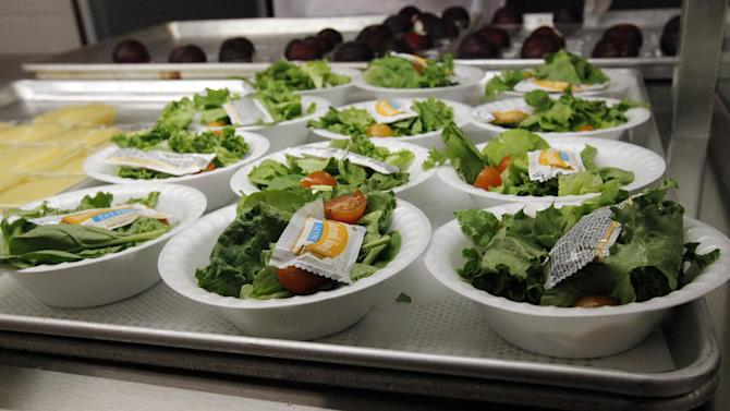 "FILE - In this Sept. 12, 2012, file photo, side salads await the students of Eastside Elementary School in Clinton, Miss. The Agriculture Department is responding to criticism over new school lunch rules by allowing kids to eat more grains and meat in the lunchroom. Agriculture Secretary Tom Vilsack said in a letter to members of Congress Friday, Dec. 7, 2012, that the department will do away with daily and weekly maximums of meats and grains. Several members of Congress have written the department since the new rules went into effect in September saying kids aren't getting enough to eat. School administrators have also complained, saying that set maximums on grains and meats are too limiting as they try to plan daily meals.  ""This flexibility is being provided to allow more time for the development of products that fit within the new standards while granting schools additional weekly menu planning options to help ensure that children receive a wholesome, nutritious meal every day of the week,"" Vilsack said in a letter to Sen. John Hoeven, R-N.D.  (AP Photo/Rogelio V. Solis, File)"