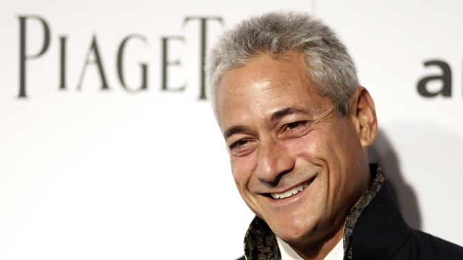 FILE - In this Oct. 27, 2011 file photo, former Olympic diving champion Greg Louganis arrives at amfAR's Inspiration Gala in Los Angeles. Louganis plans to get married this fall. People magazine says the 53-year-old Louganis will marry paralegal Johnny Chaillot. (AP Photo/Matt Sayles, File)