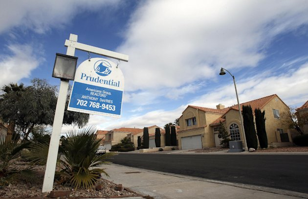 FILE - In this Friday, Dec. 2, 2011 file photo, a sign advertises a house for sale in The Lakes neighborhood of Las Vegas. The real estate and home-building sectors in the area are improving, but slow