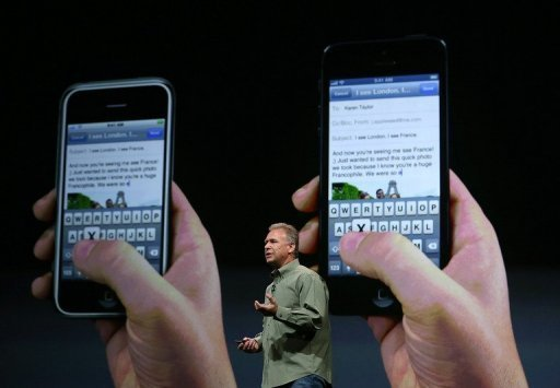 Apple Senior Vice President of worldwide product marketing Phil Schiller announces the new iPhone 5 during an Apple special event at the Yerba Buena Center for the Arts in San Francisco, California