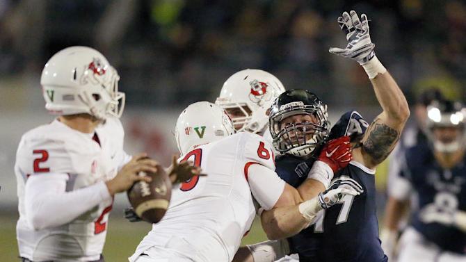 Nevada's Jordan Dobrich (49) tries to block a pass from Fresno State's Brian Burrell (2) during the second half of an NCAA college football game in Reno, Nev., on Saturday, Nov. 22, 2014