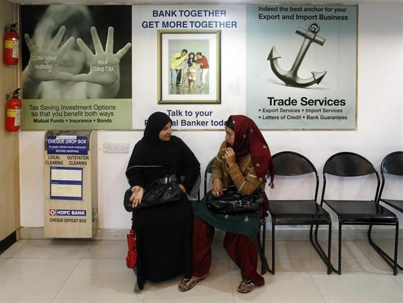 Kashmiri women talk inside a HDFC bank branch in Srinagar April 18, 2011. REUTERS/Fayaz Kabli/Files