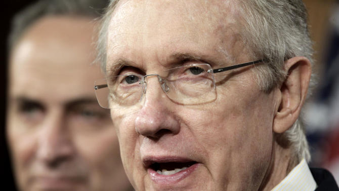 Senate Majority Leader Harry Reid of Nev., right, joined by Sen. Charles Schumer, D-N.Y,  speaks during a news conference on Capitol Hill in Washington, Friday, July 29, 2011.  (AP Photo/J. Scott Applewhite)