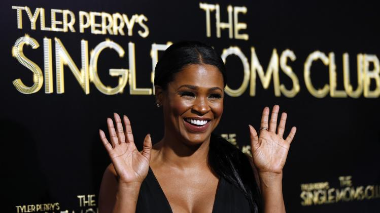 "Cast member Nia Long waves at the premiere of ""The Single Moms Club"" in Los Angeles"