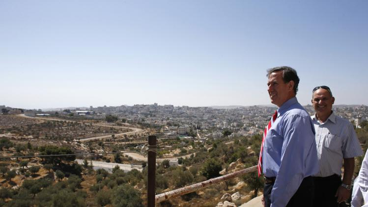 Former U.S. Senator Santorum looks at a view of the West Bank town of Bethlehem from Gilo