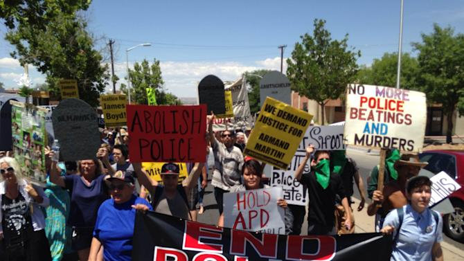 In this photo courtesy of David Correia, protesters march in a rally on Saturday, June 21, 2014 in Albuquerque, N.M. Critics of the Albuquerque Police Department say the march is aimed at pushing for drastic changes within Albuquerque police following a harsh U.S. Justice Department report over the agency's use of force. (AP Photo/Courtesy of David Correia)