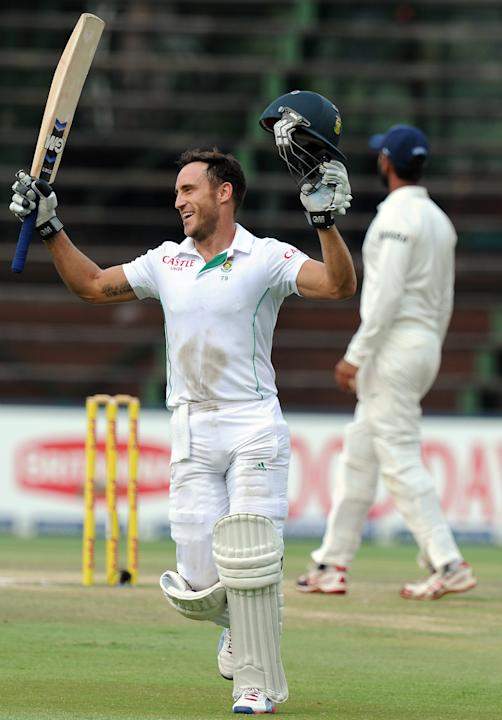 South African batsman Faf du Plessis celebrates his century on the fifth day of a first cricket Test match between South Africa and India in Johannesburg at Wanderers Stadium on December 22, 2013. AFP