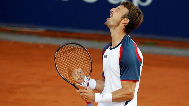 Spain&#39;s Juan Carlos Ferrero celebrates his victory during his final match against Pablo Andujar of Spain at the Stuttgart ATP Mercedes cup tennis tournament