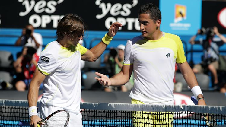 Spain's Nicolas Almagro, right, congratulates his compatriot David Ferrer after their quarterfinal match at the Australian Open tennis championship in Melbourne, Australia, Tuesday, Jan. 22, 2013. (AP Photo/Aaron Favila)