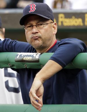FILE - In this June 25, 2011, file photo, Boston Red Sox manager Terry Francona stands in the dugout during a 6-4 loss to the Pittsburgh Pirates in an interleague baseball game in Pittsburgh. A person familiar with the decision says the Cleveland Indians on Saturday, Oct. 6, 2012, have chosen Francona to be their next manager and are working with him on a contract. (AP Photo/Gene J. Puskar, File)