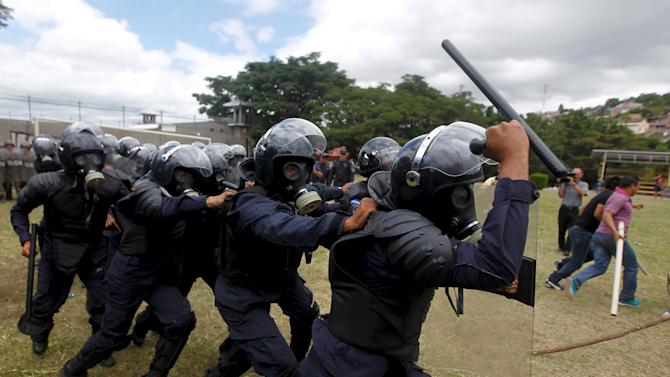 Members of the police unit for riot for law and order restoration take part in a drill at a base in Tegucigalpa