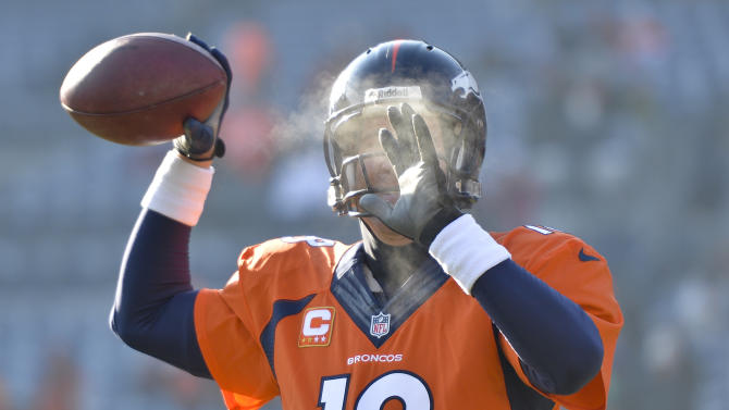 Denver Broncos quarterback Peyton Manning warms up before an NFL football game against the Tennessee Titans Sunday, Dec. 8, 2013, in Denver. (AP Photo/Jack Dempsey)
