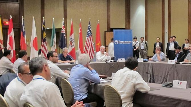 Trade ministers from 12 nations around the Pacific Rim meet at the Westin Maui in Lahaina, Hawaii,  Tuesday, July 28, 2015. The representatives are negotiating an agreement that would lower tariffs and other trade barriers while also setting labor and environmental standards for its participants. (AP Photo/Audrey McAvoy)