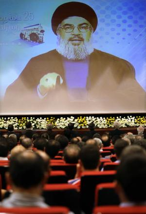 Hezbollah leader Sheik Hassan Nasrallah speaks via video during a conference, held in a southern suburb of Beirut, Lebanon, Thursday May, 9, 2013. Nasrallah said Syria will supply `game-changing' weapons to the Lebanese militant group. (AP Photo/Hussein Malla)