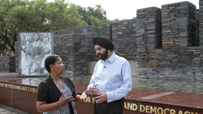 IMAGE DISTRIBUTED FOR MASTERCARD WORLDWIDE - Ajay Banga, MasterCard Worldwide President and CEO (right), speaks to Antoinette Sithole outside the iconic Hector Pieterson Memorial in Soweto near Johannesburg, during the South African leg of his Africa tour, on Wednesday Jan 16, 2013.  The memorial commemorates the 16 June 1976 Uprising in South Africa, a turning point in the country's struggle for freedom from apartheid. Sithole, who is Pieterson's sister, led Banga around a tour of the facility, providing a unique and personal insight into South Africa's history.  (Nadine Hutton/AP Images for MasterCard Worldwide)