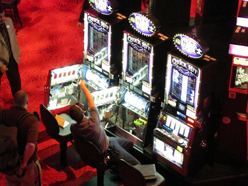 In this March 28, 2012, photo, a worker fixes some slot machines that malfunctioned at Revel, the Atlantic City N.J., casino resort that had its first trial run the same day. The resort opens to the public on Monday, April 2. (AP Photo/Wayne Parry)