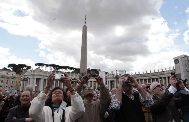 Faithful take picture of Pope Benedict XVI during the Regina Coeli in St. Peter's square at the Vatican, Sunday, April 15, 2012. (AP Photo/Gregorio Borgia)