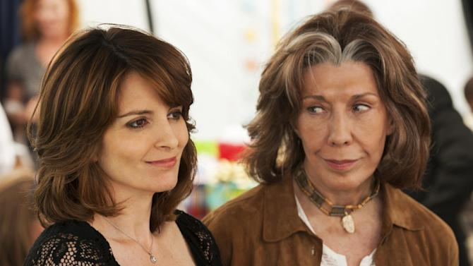 """This publicity photo released by Focus Features shows Tina Fey, left, who stars as Portia and Lily Tomlin who stars as Susannah, in a scene from the comedy/drama film, """"Admission,"""" directed by Paul Weitz. The movie is a Focus Features release opening March 22.  (AP Photo/Focus Features, David Lee)"""