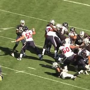 Oakland Raiders defensive lineman Justin Tuck blocks a field goal
