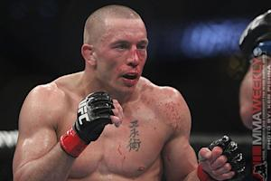 "UFC 167 Results: Georges St-Pierre Barely Hangs on to Belt, but Says He is ""Stepping Away"""