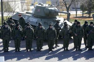 Pro-Russian separatists stand in formation in front …