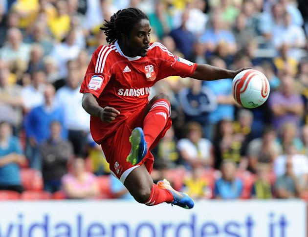 Former Swindon winger Etienne Esajas has been allowed to leave Chesterfield