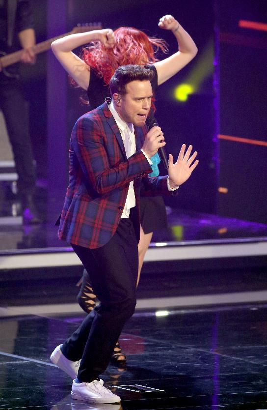 British singer Olly Murs performs before he won a Golden Camera Award for 'Best Music International' before during the awarding ceremony in Hamburg, northern Germany, Friday, Feb. 27, 2015. (AP Photo/Christian Charisius, pool)