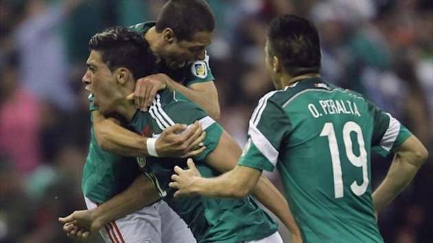 Raul Jimenez (22) of Mexico celebrates with team mates Javier Hernandez (rear) and Oribe Peralta (19)