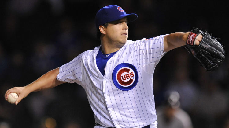 Chicago Cubs starter Jason Berken delivers a pitch in the first inning during a baseball game against the Houston Astros in Chicago, Monday, Oct. 1, 2012. (AP Photo/Paul Beaty)