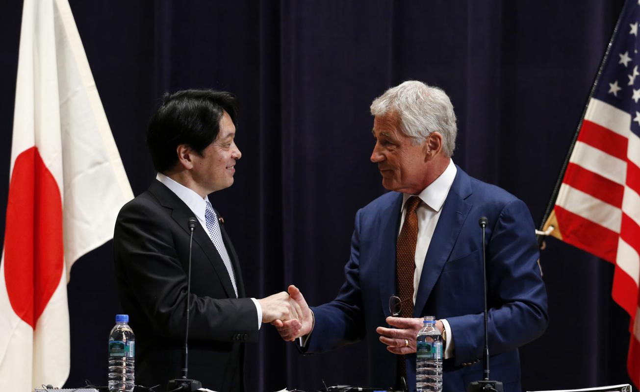 U.S. Secretary of Defense Chuck Hagel shakes hands with his Japanese counterpart Itsunori Onodera at the end of their joint news conference in Tokyo