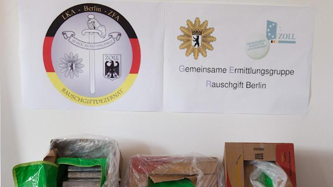 Banana boxes containing cocaine are pictured at a police station in Berlin, Germany, Monday, May 4, 2015. Berlin police say they have found about 300 kilograms (660 pounds) of cocaine inside the boxes at a national discount grocery chain in the German capital _ in what is likely the biggest discovery ever of the illegal drug in Berlin. (Soeren Stache/dpa via AP)