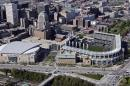 FILE - This May 20, 2005, file photo shows Jacobs Field (now Progressive Field), right, and Gund Arena (now Quicken Loans Arena) in Cleveland. When LeBron James and the Cavaliers, whose historic comeback in June against Golden State in the NBA Finals ended Cleveland's title drought dating to 1964, receive their championship rings and a banner is raised in Quicken Loans Arena before their season opener, the emotional ceremony will merely be the warm-up act. Next door, at Progressive Field, the Indians will host the Chicago Cubs in Game 1 of the World Series. (AP Photo/Mark Duncan, File)