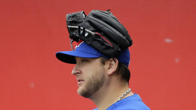 Toronto Blue Jays' Mark Buehrle walks onto the field for a workout at baseball spring training, Friday, Feb. 15, 2013, in Dunedin, Fla. (AP Photo/Matt Slocum)