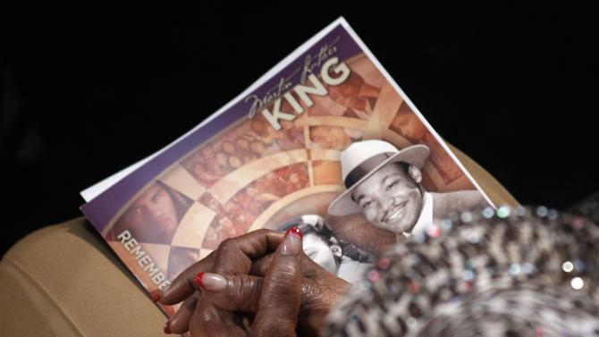 A visitor holds a commemorative booklet during the Martin Luther King, Jr. 46th Annual Commemorative Service in Atlanta