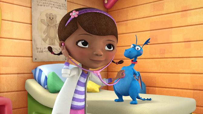 """In this image released by Disney Junior, the character Doc McStuffins is shown with Stuff in a scene from Disney Junior's animated series """"Doc McStuffins."""" The show, about a six-year-old girl who runs and operates a clinic for broken toys and worn out stuffed animals out of the playhouse in her backyard, will debut Friday, March 23, on the new 24-hour Disney Junior channel. (AP Photo/Disney Junior)"""