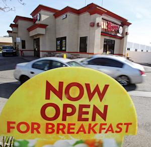 This Jan. 29, 2012 photo, shows signage promoting breakfast is at a Wendy's restaurant in Culver City, Calif. Wendy's edged out Burger King in U.S. sales volume for the first time last year since Wendy's was founded in 1969, according to a report by the food industry research firm Technomic Inc. that's set to be released next month. (AP Photo/Reed Saxon)