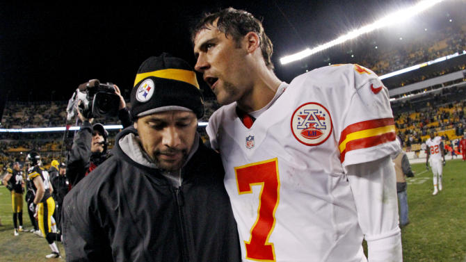 Kansas City Chiefs quarterback Matt Cassel (7) talks with Pittsburgh Steelers strong safety Troy Polamalu after an NFL football game in Pittsburgh, Monday, Nov. 12, 2012. The Steelers won 16-13 in overtime. (AP Photo/Gene J. Puskar)