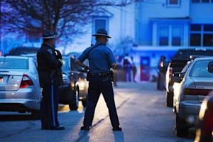 Law enforcement officials stand on Franklin St. as the search for Dzhokhar Tsarnaev, suspect in the Boston Marathon bombings, comes to an end in Watertown