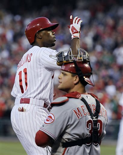 Lee, Rollins lead Phils over Reds