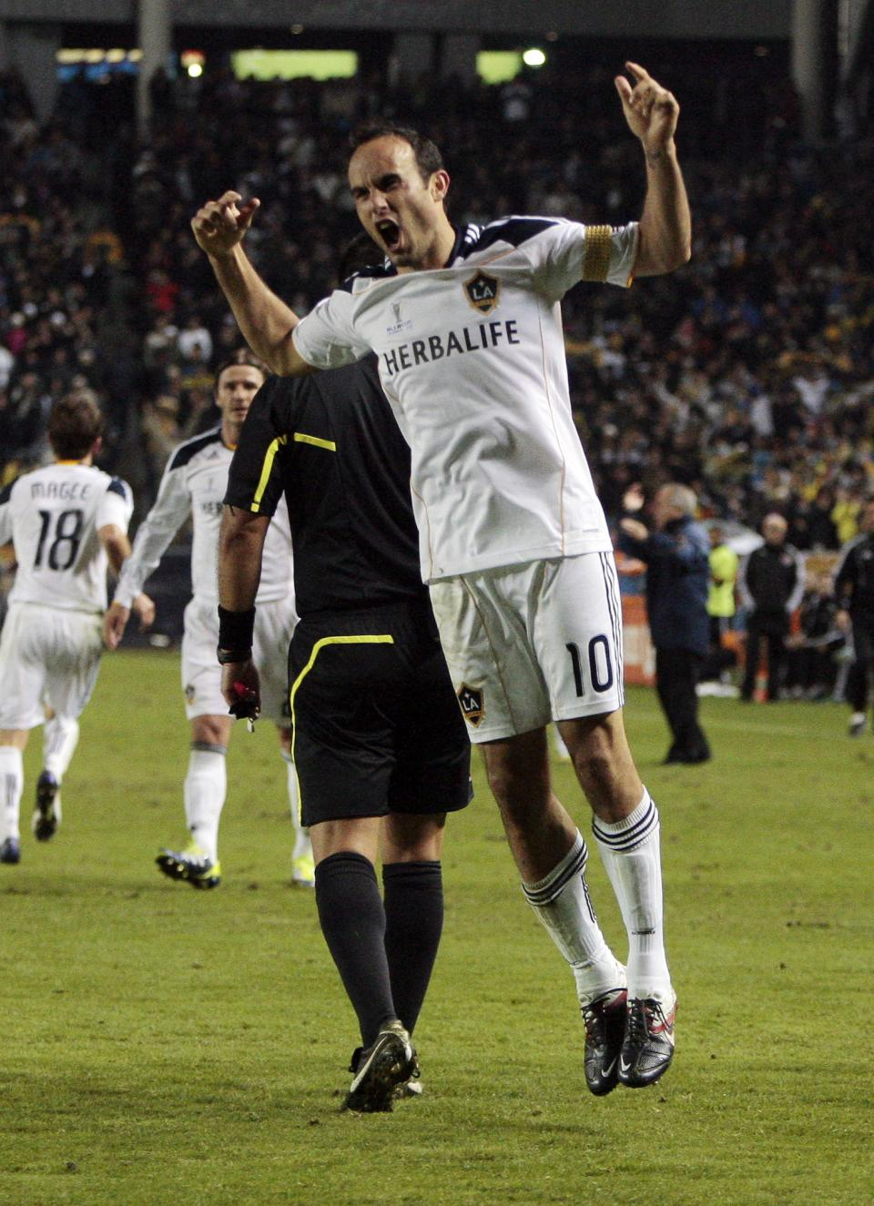 Los Angeles Galaxy forward Landon Donovan (10) celebrates his goal during the second half of the MLS Cup championship soccer match against the Houston Dynamo, Sunday, Nov. 20, 2011, in Carson, Calif. The Galaxy won 1-0. (AP Photo/Bret Hartman)