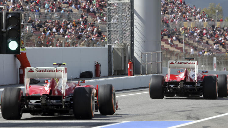 Ferrari driver Fernando Alonso of Spain leads his teammate Felipe Massa of Brazil during the third free practice session at the Catalunya racetrack in Montmelo, near Barcelona, Spain, Saturday, May 11, 2013. The Formula One race will be held on Sunday. (AP Photo/Luca Bruno)