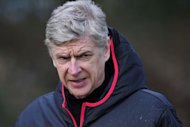 Arsenal manager Arsene Wenger takes training before Tuesday's Champions League last 16 match against Bayern Munich at Arsenal's training ground at London Colney, north of London, on February 18, 2013. Wenger rounded angrily on his critics ahead of Tuesday's crucial Champions League clash