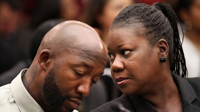 Trayvon Martin's parents, father, Tracy Martin, left, and mother Sybrina Fulton, attend a House Judiciary Committee briefing on racial profiling and hate crimes, Tuesday, March 27, 2012, on Capitol Hill in Washington. (AP Photo/Jacquelyn Martin)