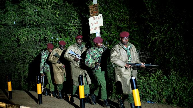 Kenyan Defense Forces leave the near vicinity of the Westgate Mall in Nairobi Kenya Monday Sept. 23 2013. Multiple large blasts have rocked the mall where a hostage siege is in its third day. Associated Press reporters on the scene heard multiple blasts and a barrage of gunfire. Security forces have been attempting to rescue an unknown number of hostages inside the mall held by al-Qaida-linked terrorists. (AP Photo/ Jerome Delay)