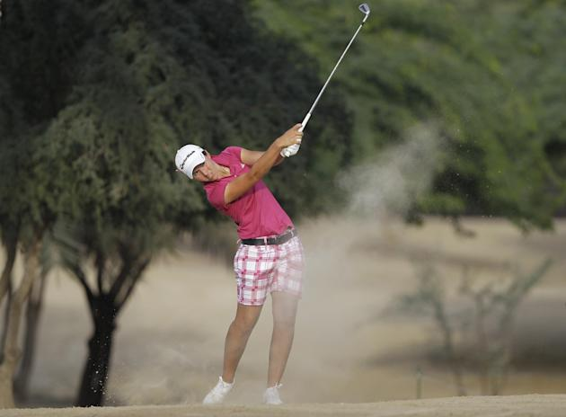 Carlota Ciganda of Spain plays a ball on the 14th hole during the 3rd round of Dubai Ladies Masters golf tournament in Dubai, United Arab Emirates, Friday, Dec. 6, 2013